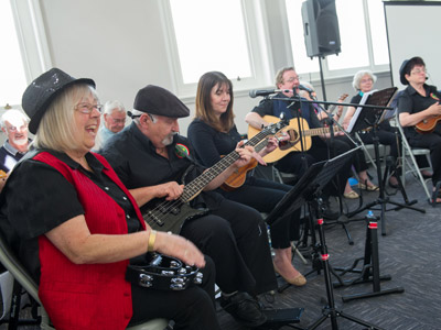 Rhythm & Ukes group performing at the exhibition launch